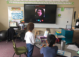 student participate in Skype call with family affected by California wildfires